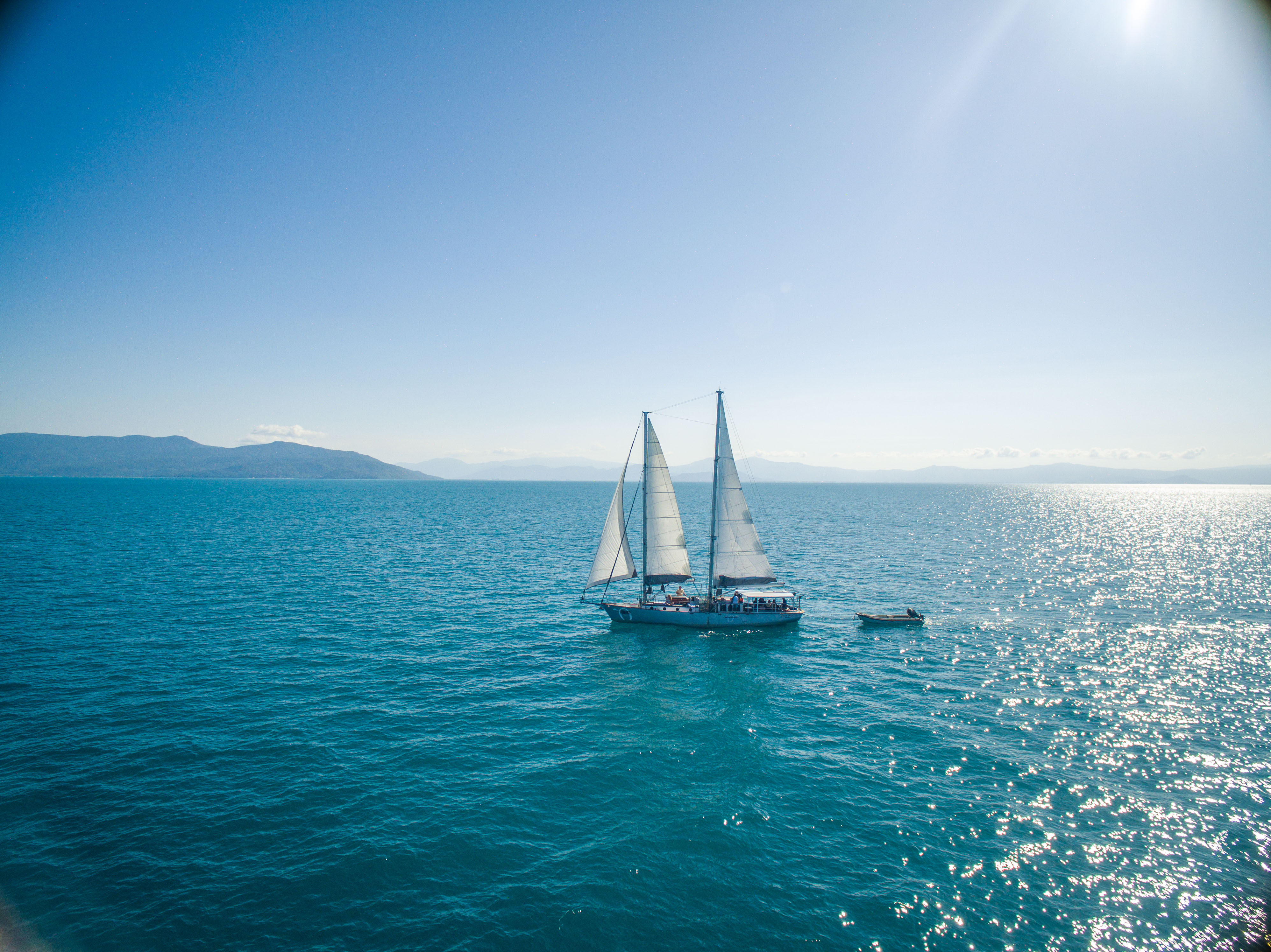 Ocean Free is a 16.5 metre sailing schooner. Check in at Reef Fleet Terminal from 7.15am at Ocean Free + Ocean Freedom desk. Board from 7.30am A Finger No. 4 at the Marlin Marina, Cairns for an 8am departure – coffee, tea and Danish pastries and fresh fruit served on boarding.