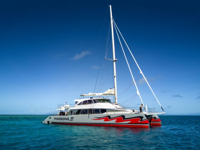 A flat carefully designed wrap-around deck means no obstacles to trip up unwary passengers.  The boat boasts a fully stocked bar and commercial galley.  Entrance in and out of the water is simple and easy through the double rear steps on the stern.